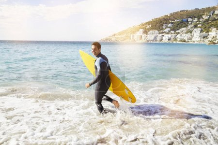 Surfer with surfboard running