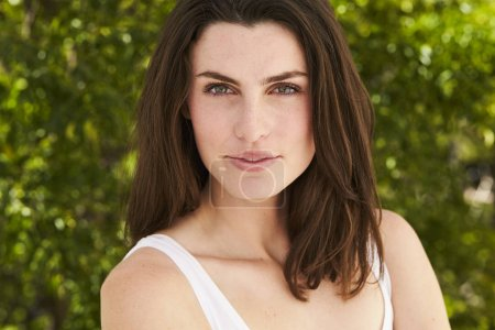 Photo for Beautiful brunette woman looking at camera, smiling - Royalty Free Image