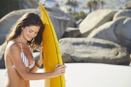 girl with surfboard on beach