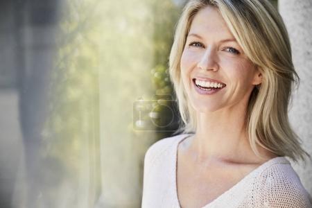 Happy attractive woman smiling