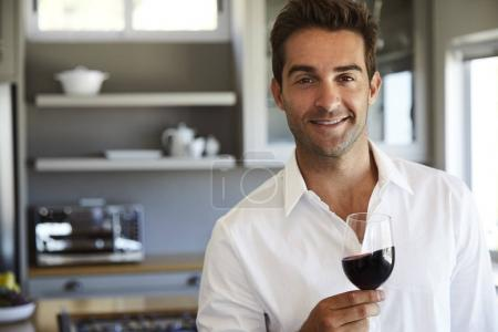 young man with glass of red wine