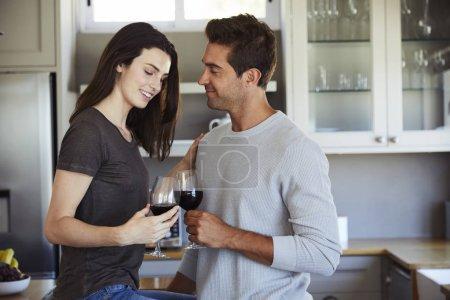 Loving couple enjoying wine