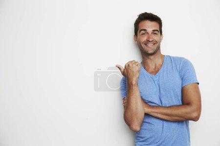 Guy in blue t-shirt gesturing