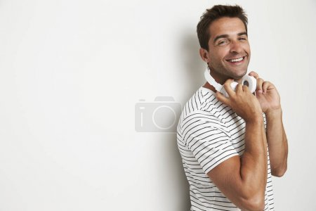 Photo for Handsome man with headphones in studio smiling - Royalty Free Image