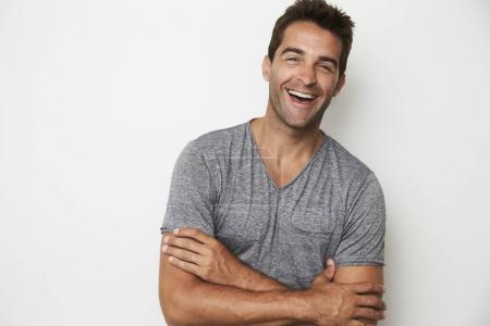 Photo for Hot man standing by wall and looking at camera - Royalty Free Image