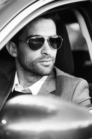 Photo for Close up of handsome man sitting in car - Royalty Free Image