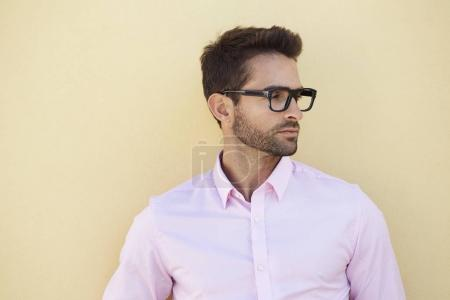 Photo for Close up of good looking guy in glasses and pink shirt - Royalty Free Image