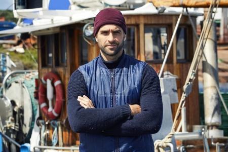 Serious fisherman wearing knitwear