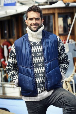 fisherman in pullover and body warmer