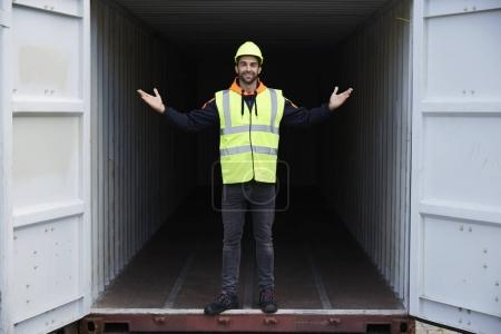 guy marveling at size of container