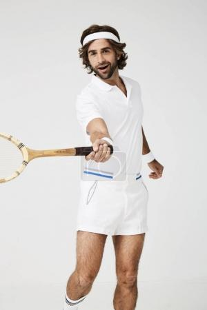 Tennis guy with racket ready to play