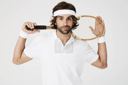 Posing tennis player holding racket