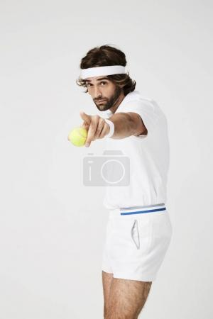 Tennis player aiming with ball