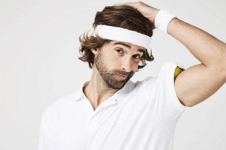 Posing tennis player