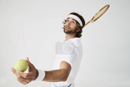 tennis player ready to strike the ball