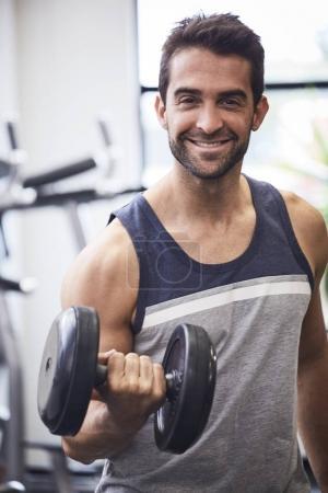 Man curling biceps
