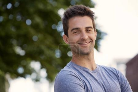 Smiling guy in blue t-shirt