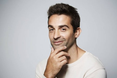 Photo for Handsome dude with hand on chin, portrait - Royalty Free Image