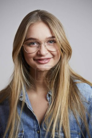 Cool girl in glasses and shirt, smiling