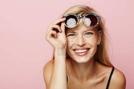 Photo for Portrait of glamorous girl with sunglasses, pink background - Royalty Free Image