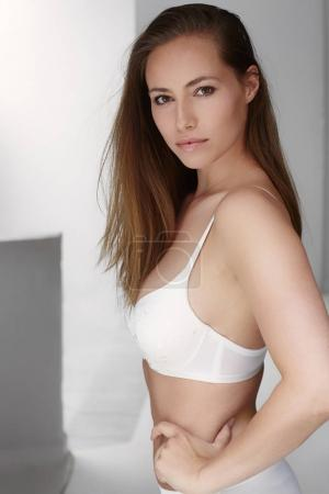 Young woman in bra posing looking at camera