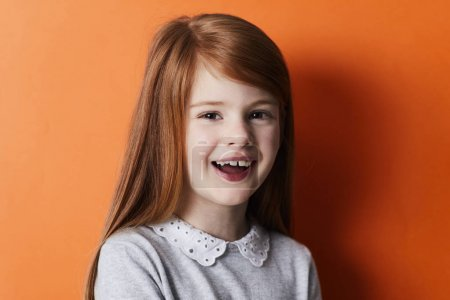 Joyful redheaded girl portrait