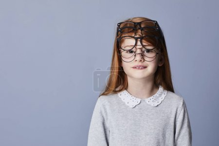 Redheaded little girl with many spectacles, portrait