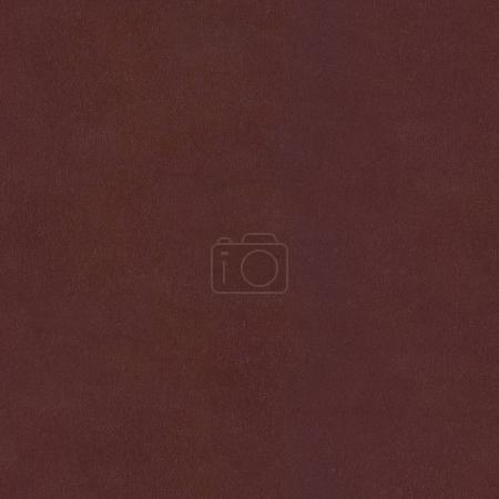 Closeup of brown leather background. Seamless square texture, ti