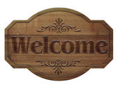 Wooden sign in a dark wood with the words welcome, isolated