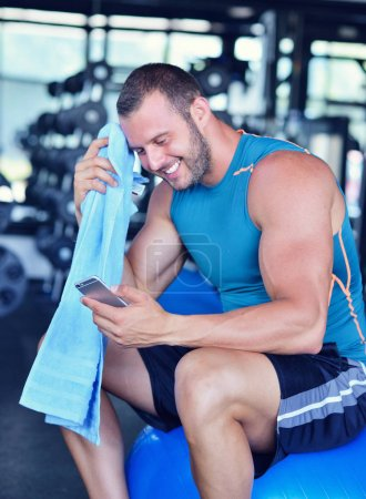 young man in fitness sport club