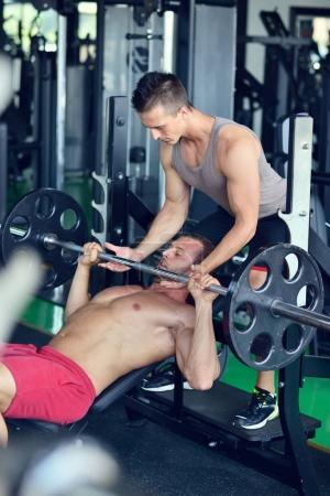 two handsome bodybuilders working out