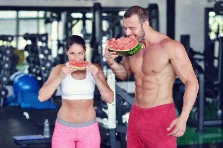 couple of bodybuilders with watermelon