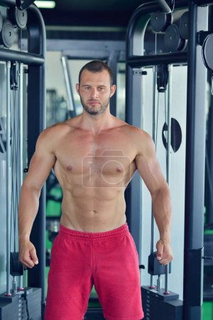 man posing at gym