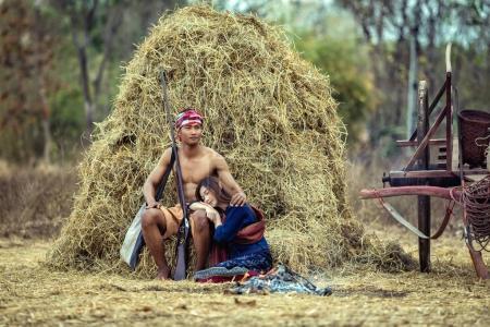 Farmer couple Thailand Sitting near a pile