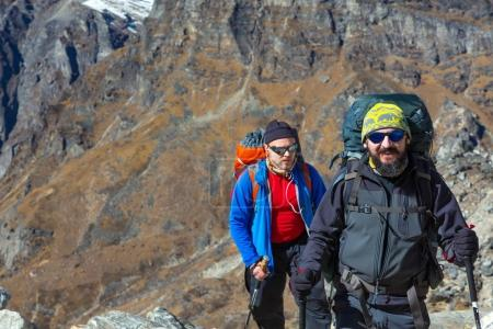 Hikers walking on Mountain Terrain