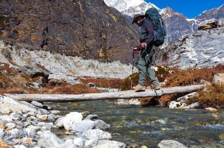 Hiker passing Mountain Creek