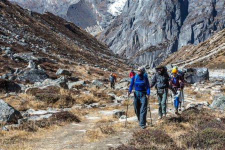 Photo for Sport Team of Mountain Climbers walking on Footpath among Rocks - Royalty Free Image