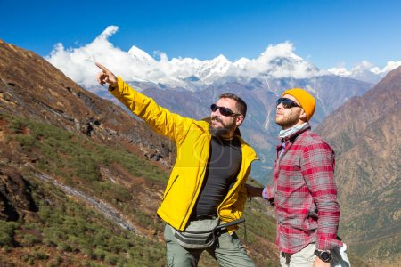 Men staying on Mountain and pointing