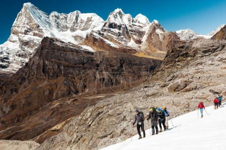 Mountain Climbers led by elder Guide
