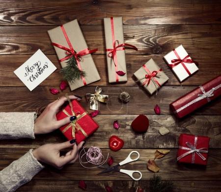 Woman carefully preparing gifts