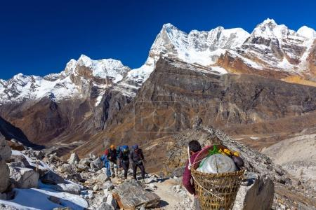 Group of Hikers and Nepalese Porter