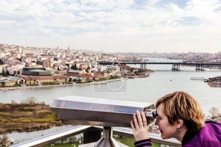 Woman looking throw Binoculars