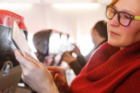 Female Passenger using Tablet