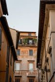 Low angle view of old buildings in historical centre of Rome a s
