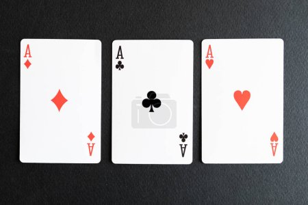 Photo pour Playing cards, casino game, black background - image libre de droit