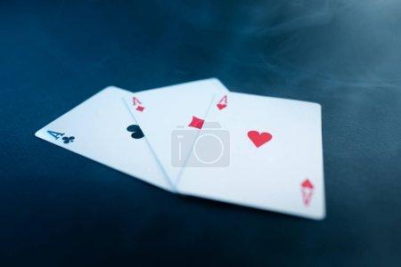 Photo pour Playing cards, casino game, blue background - image libre de droit
