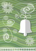 Christmas decoration with paper cut xmas symbols on green wavy background christmas bell and lace stars