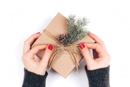 Woman's hands wrapping box