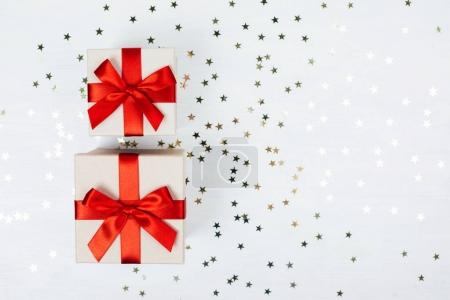 Two presents with red bows