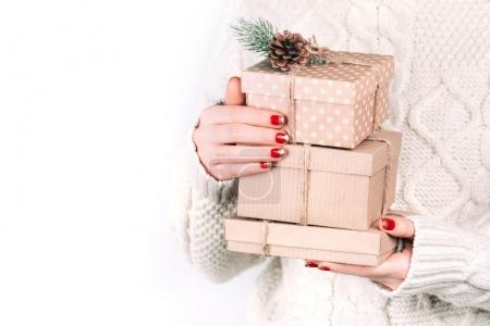 Hands with craft gift boxes